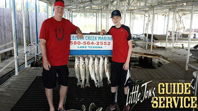 Father and son catching striper.jpg